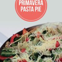 Primavera Pasta Pie topped with shredded Parmesan cheese