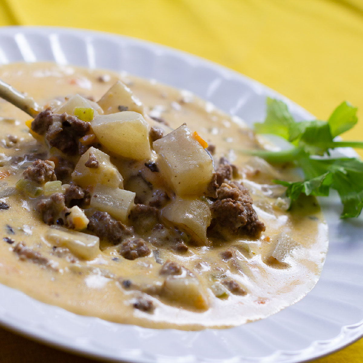 Easy Cheeseburger Soup with Velveeta Cheese and diced potatoes in a bowl.