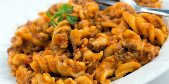 Spiral pasta with ground beef in a tomato cheese sauce and