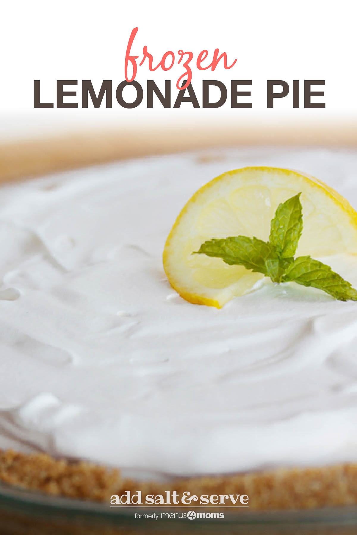 Pie with white frozen filling and graham cracker crust garnished with a twisted slice of lemon and mint with text Frozen Lemonade Pie
