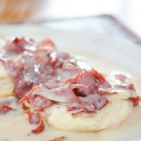 Chipped Beef Gravy and Biscuits on a white plate