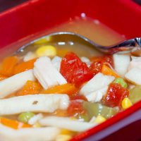 Red square soup bowl with homemade turkey noodle soup.