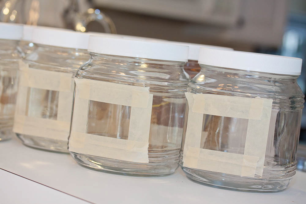 glass jars with a rectangle outlined in masking tape
