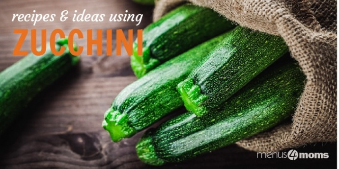 Jute bag filled with zucchini on a wooden surface with text Recipes & ideas using zuccini