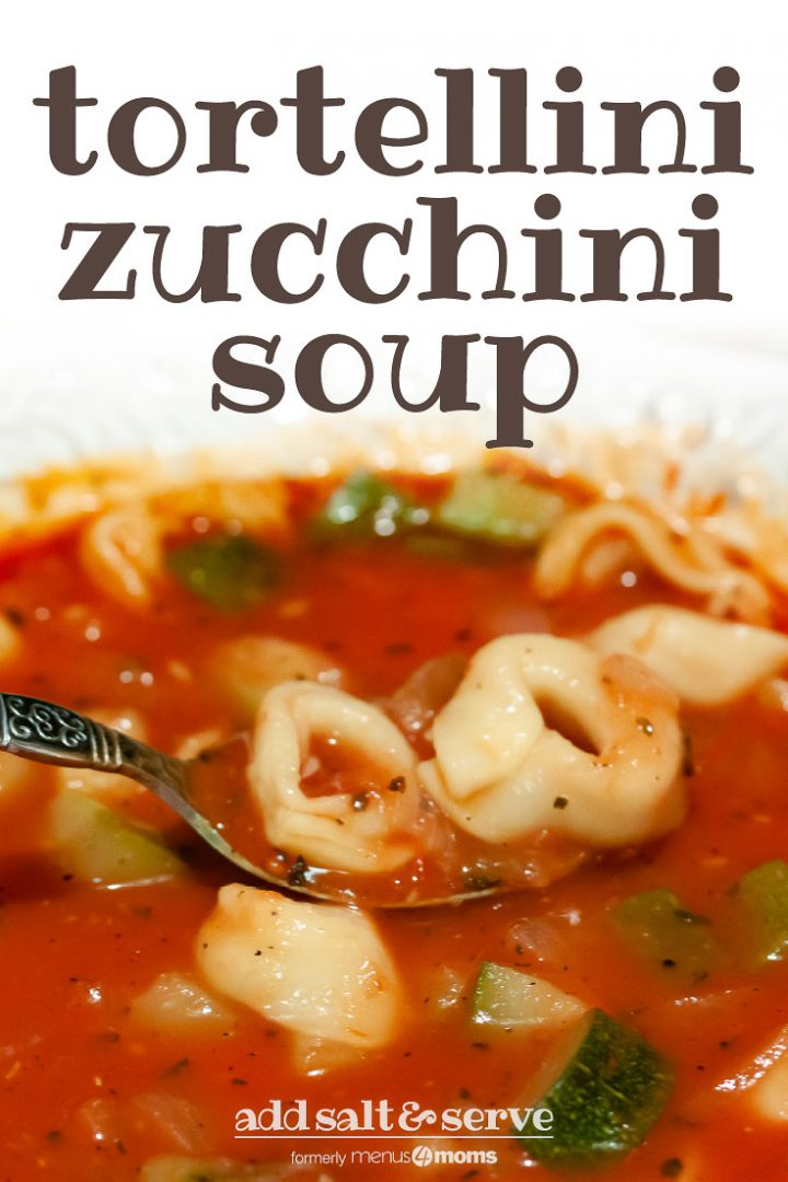 bowl of tomato soup with zucchini and tortellini with text Tortellini Zucchini Soup