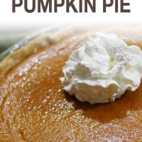 Baked pumpkin pie garnished with whipped cream and text Classic Pumpkin Pie (Add Salt & Serve logo)