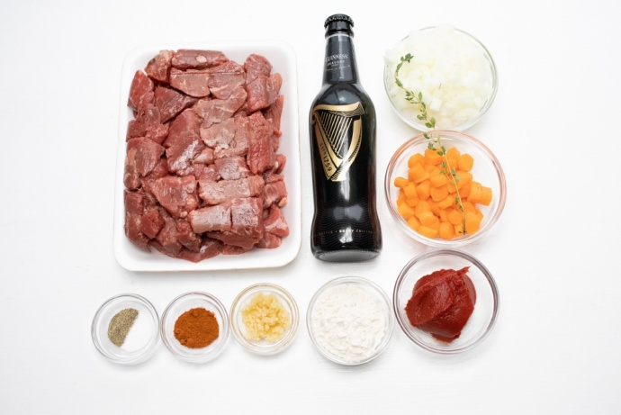 Ingredients: Beef stew meat, a bottle of guinness beer, chopped onion, chopped carrot, tomato paste, flour, minced garlic, paprika, thyme, salt, and pepper