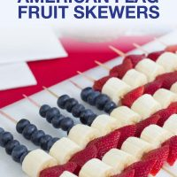 Blueberries, strawberries, and bananas threaded on bamboo skewers in the design of an American flag
