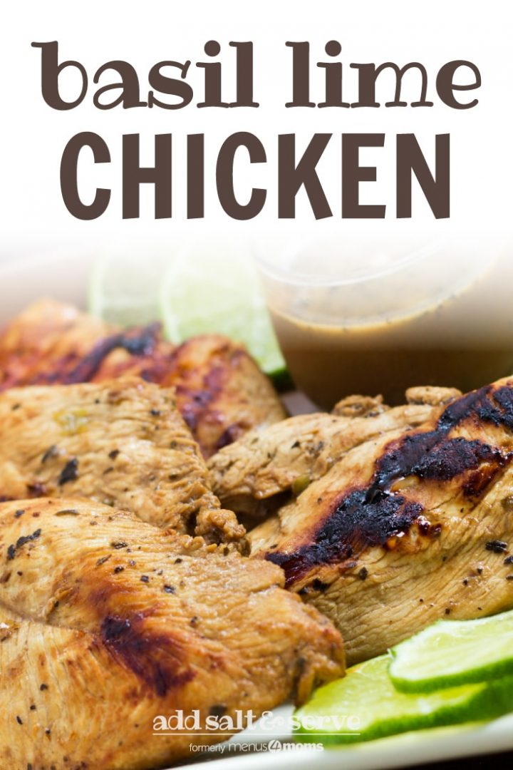 Grilled chicken on a square plate, garnished with lime slices. A small clear glass cup of Dijon basil lime dipping sauce is on the plate. Text Basil Lime Chicken add salt & serve formerly menus4moms