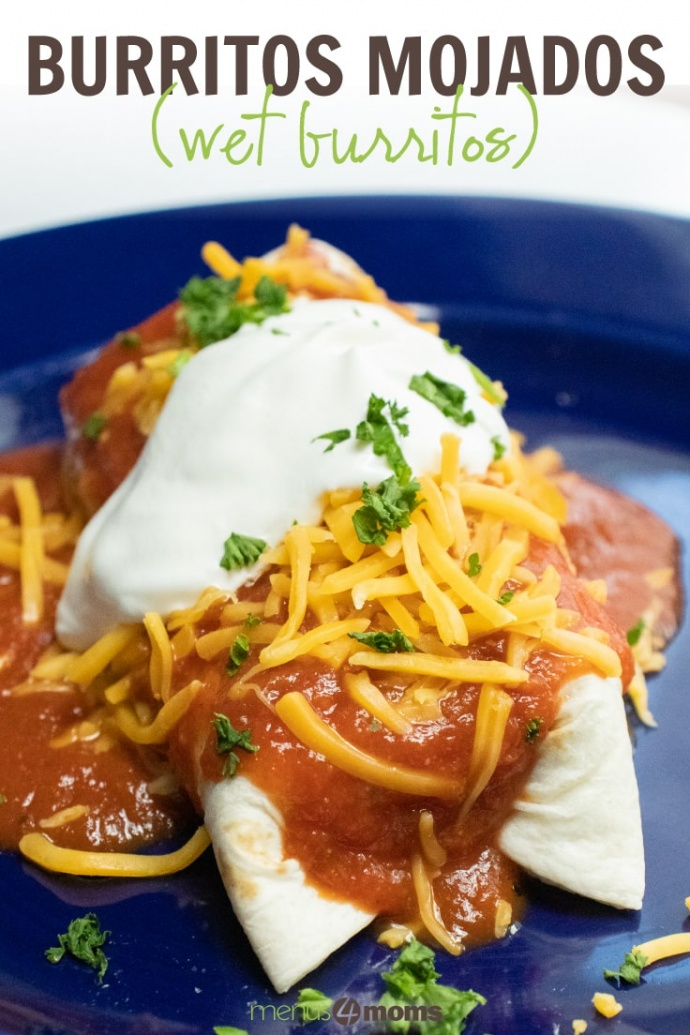 Blue plate with a burrito covered in red sauce and garnished with cheese, sour cream, and cilanto with text Burritos Mojados (wet burritos) Menus4Moms