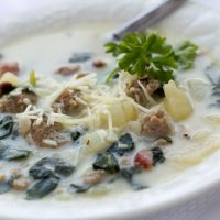 Bowl of soup with spinach, potatoes, bacon and cheese