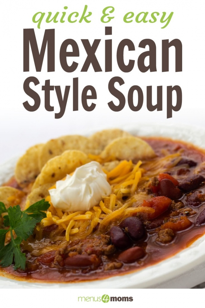 White bowl filled with soup of beans, tomatoes, and beef, topped with shredded cheddar cheese, tortilla chips, and sour cream, garnished with cilantro; text quick and easy mexican style soup menus4moms