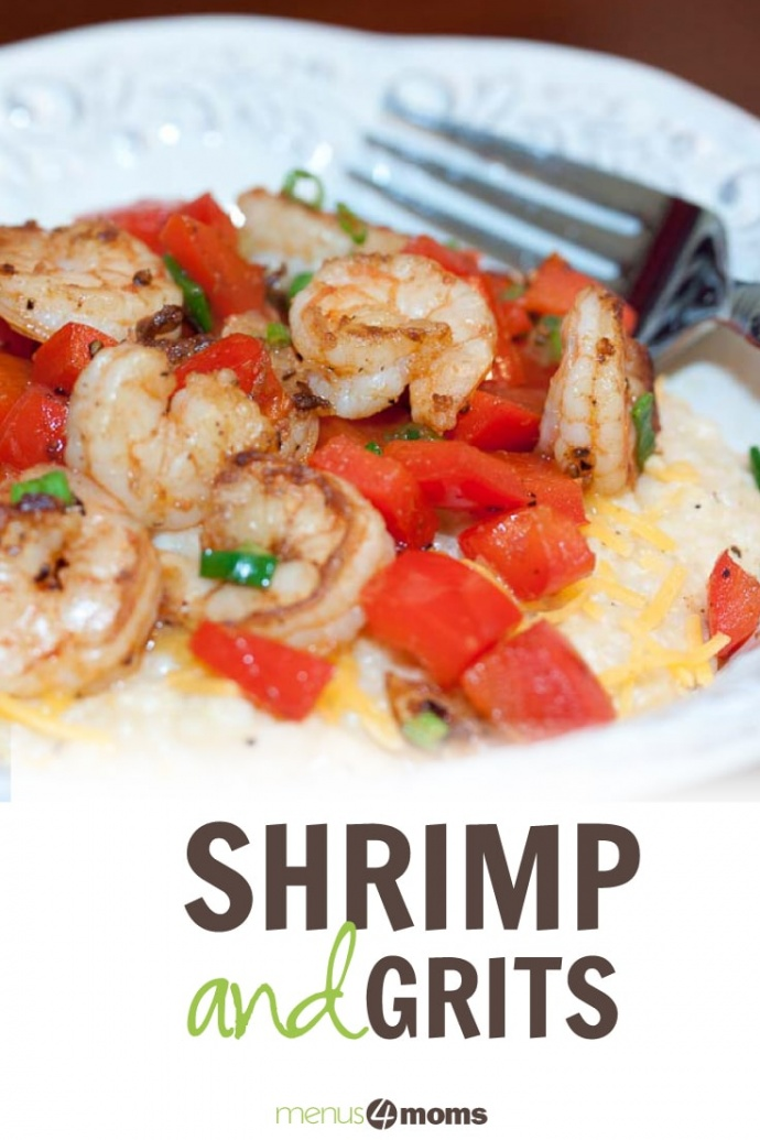 White bowl with grits topped with cooked shrimp, diced red pepper, chopped green onion, and shredded cheddar cheese with text Shrimp and Grits Menus4Moms