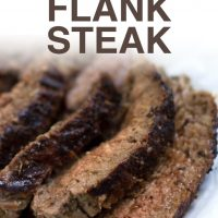 Seaasoned and grilled flank steak sliced and plated with juices and text Italian Flank Steak