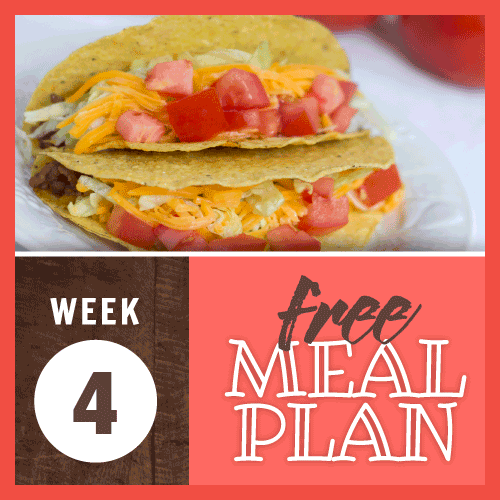 Week 4 free meal plan; image of beef tacos in a hard shell garnished with shredded cheddar cheese, diced tomatoes, and shredded lettuce
