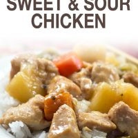 Chunks of cooked chicken, pinapple, carrots, and peppers served over white rice with text slow cocoker sweet and sour chicken