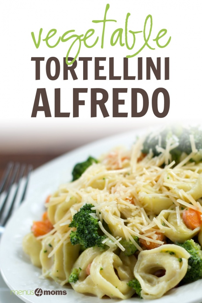 Plate of cooked tortellini and Alfredo sauce with broccoli and carrots garnished with shredded Parmesan cheese; text Vegetable Tortellini Alfredo Menus4Moms