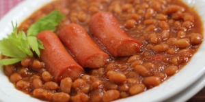 Beans and Franks in a white serving bowl