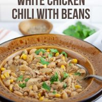 Slow Cooker White Chicken Chili with Beans Garnished with Cilantro - Add Salt & Serve