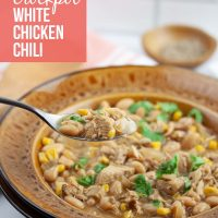 Crockpot White Chicken Chili Garnished with Cilantro - Add Salt & Serve
