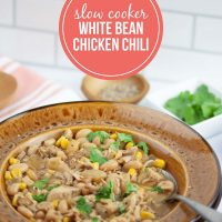 Slow Cooker White Bean Chicken Chili Garnished with Cilantro - Add Salt & Serve