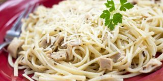 Lemony Pasta with Chicken on a red plate