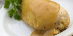 Maple Dijon Chicken garnished with parsley on a white plate