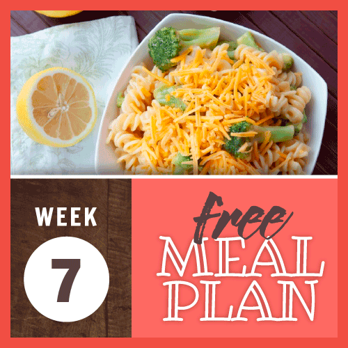 Week 7 free meal plan; overhead view of spiral pasta and broccoli topped with shredded cheddar cheese