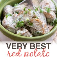 Bowl of potato salad garnished with parsley with a fork and text Very Best Red Potato Salad - Add Salt & Serve logo