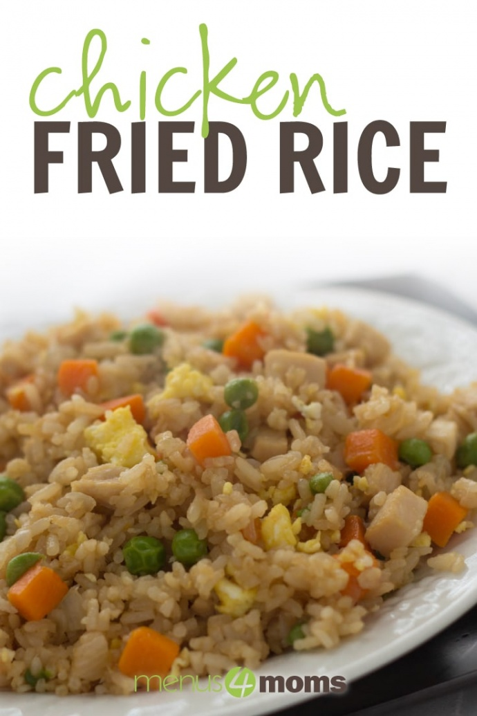 Chicken Fried Rice with carrots, peas, egg, and chicken mixed in with the rice on a white plate with text Chicken Fried Rice