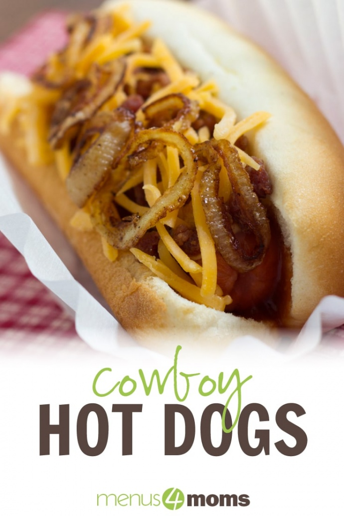 Hot dog in bun topped with sautéed onion and grated cheddar cheese with text Cowboy Hot Dogs