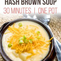 Overhead shot of a bowl of Hash Brown Potato Soup topped with shredded cheddar cheese and garnished with diced green onions. Text is Stovetop Hash Brown Soup 30 Minutes | One Pot - Add Salt & Serve logo