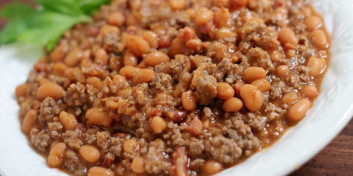 Bowl of cooked ground beef and pinto beans in sauce