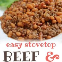 Bowl of cooked ground beef and pinto beans in sauce with text Beef With Beans Menus4Moms
