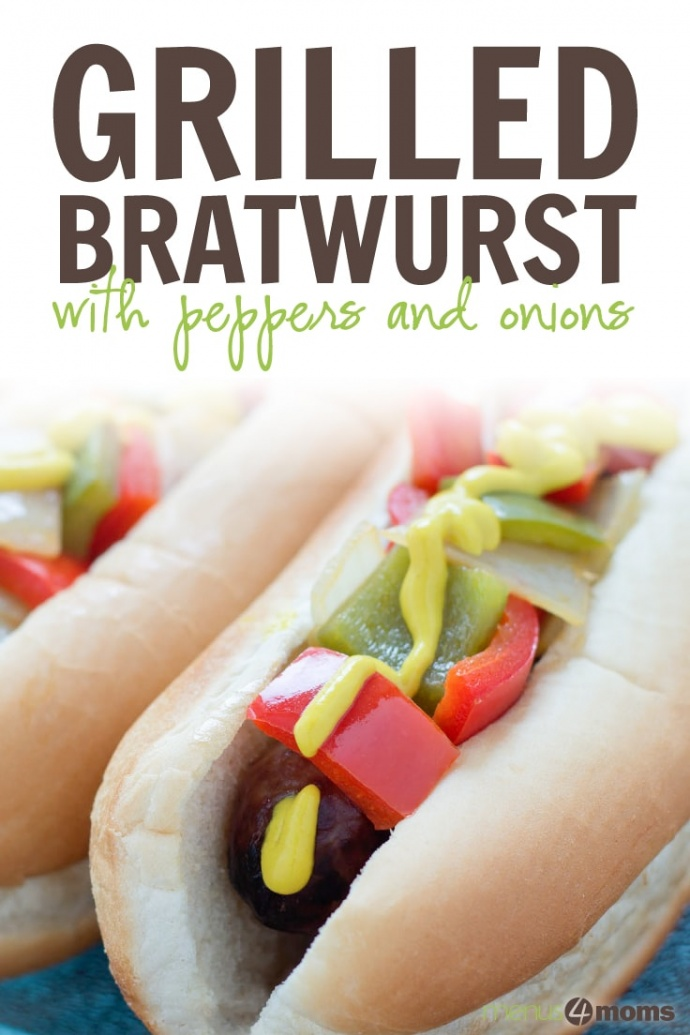 Bratwurst on a hotdog bun with mustard, diced red and green bell peppers and diced onions; text Grilled Brats with Peppers and Onions Menus4Moms