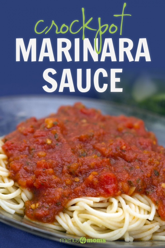 A pile of cooked spaghetti noodles covered with marinara sauce on a blue plate; text Crockpot Marinara Sauce Menus4Moms
