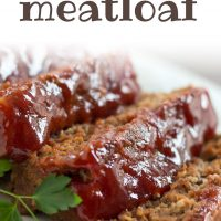 Slices of glazed meatloaf on a white plate. Text Glazed Meatloaf Add Salt & Serve formerly menus4moms