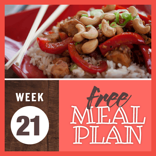 Week 21 Free Meal Plan; image of chicken and red pepper slices in peanut sauce served over whtie rice on a red plate with chopsticks