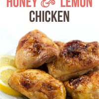 Four pieces of baked chicken on a white plate with lemon slices; text Baked Honey & Lemon Chicken - Add Salt & Serve logo