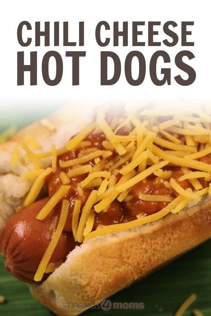 Hot dog in a bun, covered with chili and shredded cheddar cheese, with a green background; text Chili Cheese Hot Dogs Menus4Moms