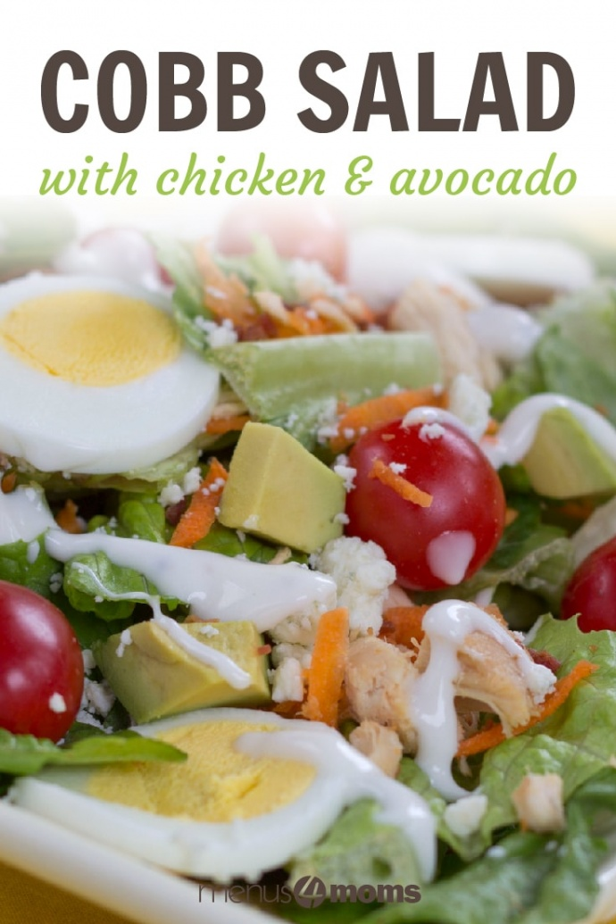 Cobb salad on a white square plate on a yellow tablecloth. Cobb salad ingredients are lettuce, grape tomatoes, sliced boiled eggs, diced avocado, diced chicken, shredded carrots, and blue cheese dressing; text Cobb Salad with Chicken & Avocado Add Salt & Serve