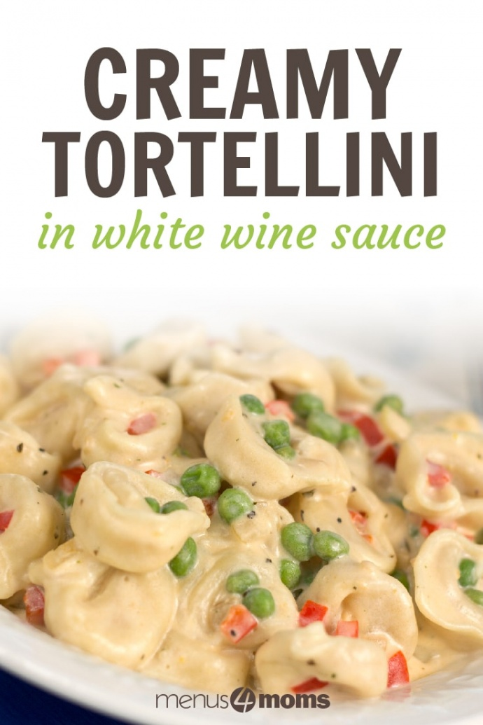 Blue platter with white plate full of tortellini covered in a white wine sauce, green peas, diced red bell pepper, and basil; text Creamy Tortellini in white wine sauce Menus4Moms