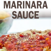 Spaghetti topped with marinara sauce and grated parmesan cheese; text crockpot marinara sauce add salt & serve formerly menus4moms