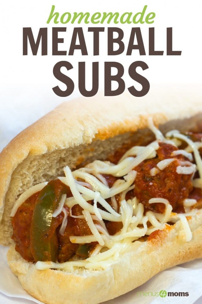 Meatballs, sauce, shredded mozarrella cheese, and strips of bell peppers on a hot dog bun, all on a white plate; text Homemade Meatball Subs Menus4Moms