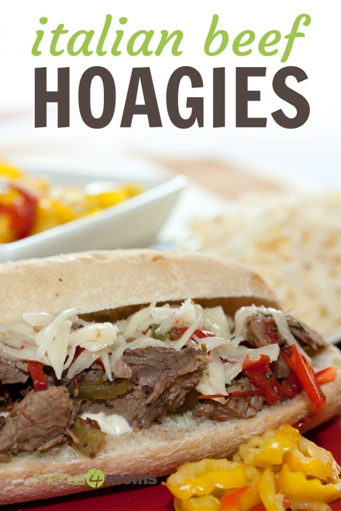 A hoagie roll on a red plate with shredded roast beef, onions, and bell peppers, with a white bowl of pickled peppers in the background; text Italian Beef Hoagies Menus4Moms