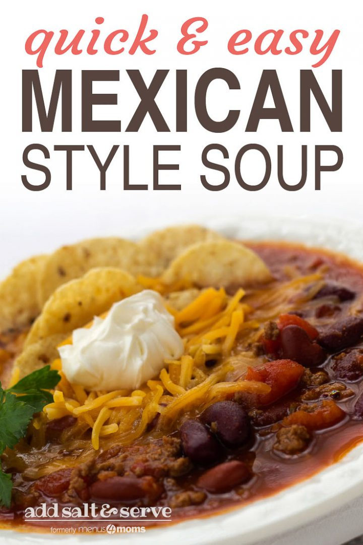 White bowl filled with soup of beans, tomatoes, and beef, topped with shredded cheddar cheese, tortilla chips, and sour cream, garnished with cilantro; text quick and easy mexican style soup Add Salt & Serve formerly Menus4Moms