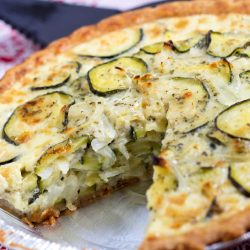 Zucchini quiche with a slice missing