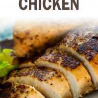 Sliced chicken breast on a white plate; text baked skillet chicken add salt & serve formerly menus4moms