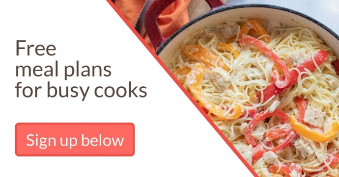 Overhead shot of cooked spaghetti, red and yello bell peppers, onions, and cheese cooked in a red cast iron skillet with text Add Salt & Serve Free Meal Plans for Busy Cooks