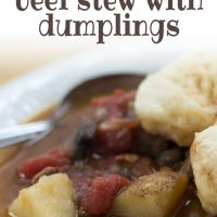 White bowl of beef stew with two dumplings on top. Stew consists of brown broth, diced beef, chopped potatoes, and stewed tomatoes. There is a spoon in the bowl on the left side. Text savory beef stew with dumplings add salt&serve, formerly menus4moms.